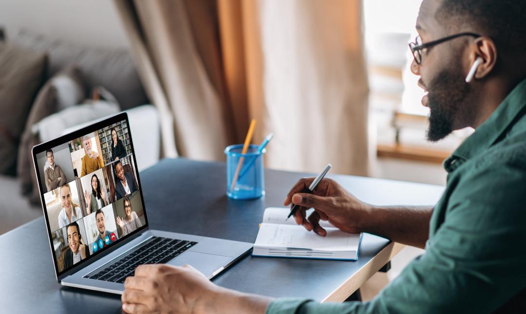 Man using laptop in a meeting